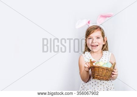 Happy Cute Girl With Bunny Ears. Easter Greeting Card Background