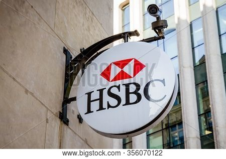 Paris/france - September 10, 2019 : The Hsbc Banking Agency Entrance Sign On Champs-elysees Avenue