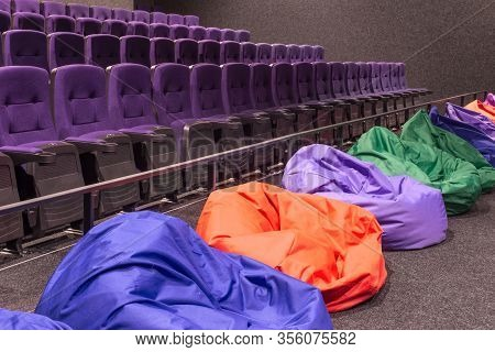General Plan Of Pink Red Empty Unoccupied Seats In The Cinema Hall. Watching A New Movie