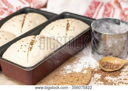 Making Bread. The Dough Is In The Mold For Bread. Sprinkle Bread With Flax Seeds.