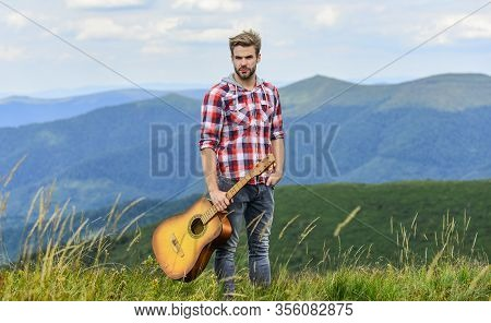 Inspiring Environment. Summer Music Festival Outdoors. Playing Music. Man Musician With Guitar On To