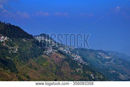 View Across Downtown Of Darjeeling Towards The Dramatic Mountain Range Of Kanchenjunga