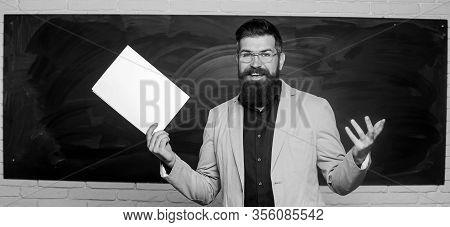 Teacher Paperwork. School Principal. Demanding Teacher. Lecturer In Classroom. Explaining Theory. Co