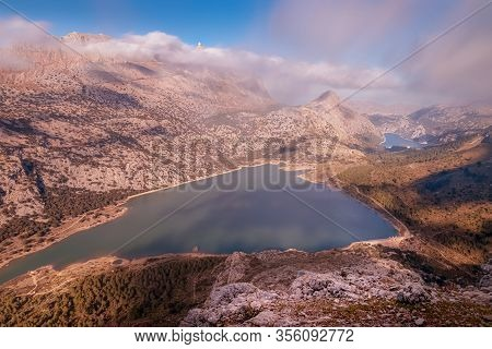 Puig Major With Cuber And Gorg Blau Reservoirs, Sun And Blue Skies With Low White Clouds, Tramuntana