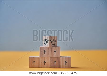 Business And Career Growth. Goal Achievement, Career Ladder. Pyramid Of Wooden Blocks, Crown And Tar