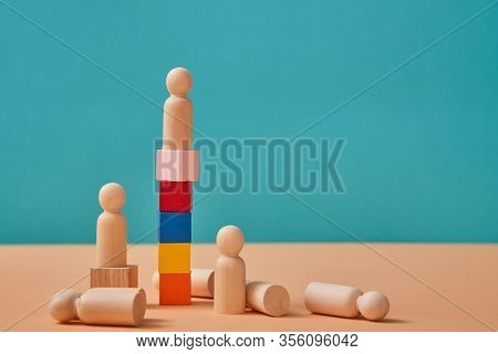 Career Ladder. Reach Goal And Winning. Leadership, Professional Growth. Leader Miniature On Cubes To