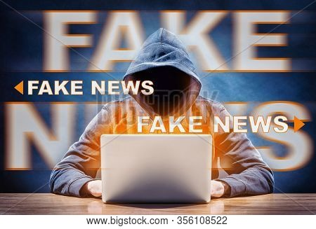 A Hacker Spreading Fake News From A Laptop