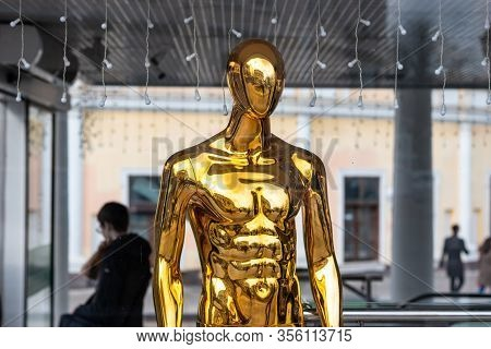 Gold Fashion Clothing Store Mannequin, Shop Window Mannequin. Sale And Discounts Concept.
