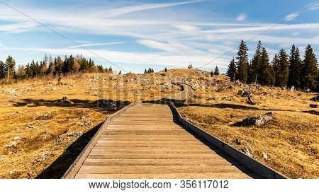 Wooden Path At The Top Of Schockl Mountain In Graz Austria Leading To View Point. Mountain Andscape