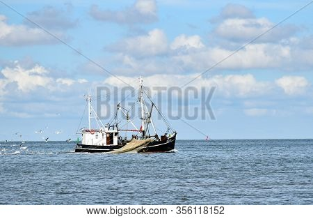 Buesum, Germany - August 1, 2018: The Fishing Boat With The Name Sd 16 Is Fishing In The North Sea N