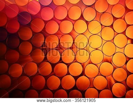 Abstract Warm Red And Orange Toned Vivid Colorful Background Texture Of Backlit Stack Drinking Straw