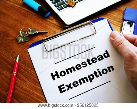 Man Is Reading Homestead Exemption At The Home.