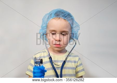 Small Boy Playing Doctor Wearing A Stethoscope