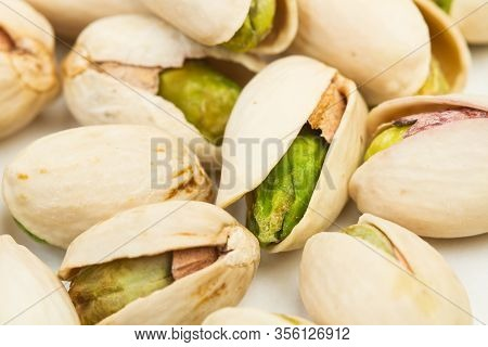Unpeeled Green Pistachios Isolated On A White Background In A Close Up View