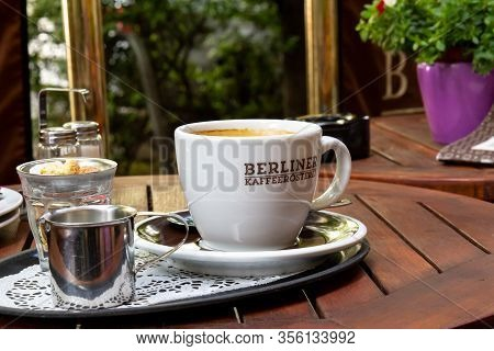 Berlin, Germany - June 1, 2019: A Nice Blank White Cup Of Coffee On A Metal Tray Gives A Calm Feelin