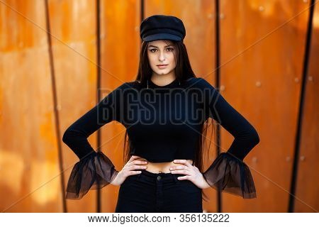 Fashion Portrait Of Stylish Pretty Brunette. Young Woman Outdoor. Cool Hipster Student Woman. Trendy