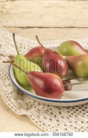 Fresh And Ripe Pears On A Wooden Table With Copy Space