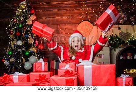 Child Happy Excited Girl Find Gifts Near Christmas Tree. Merry Christmas. Happy Childhood Concept. K