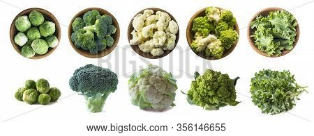 Brussels Sprouts, Broccoli, Cauliflower, Roman Cauliflower And Kale Leaves In Wooden Bowl Isolated O
