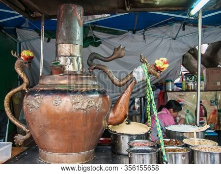 Guilin, China - May 10, 2010: Downtown. Closeup Of Giant Dragon-decorated Copper Cooking Vessel At M