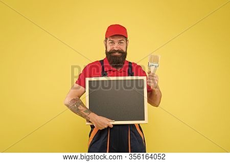 Painting Works. Bearded Decorator Hold Blackboard Copy Space. Repair Tips. Happy Hours. Man Worker W