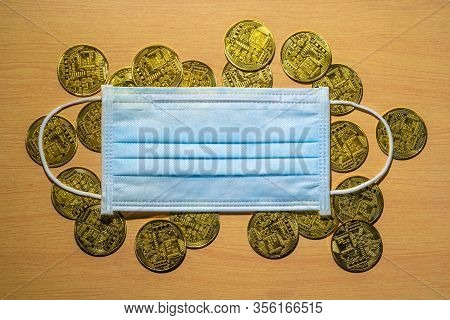 Gold Coins With A Medical Mask. A Business Finance Concept