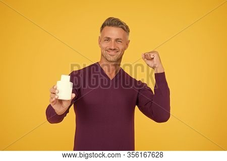Smell Good All Day. Happy Guy Hold Cologne Bottle. Personal Hygiene. Handsome Man Presenting Hygiene