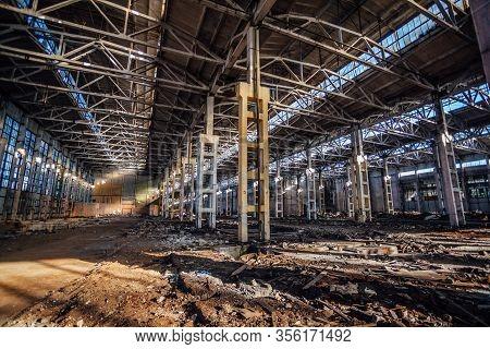 Abandoned Large Industrial Hall With Garbage Waiting For Demolition. Former Voronezh Excavator Manuf
