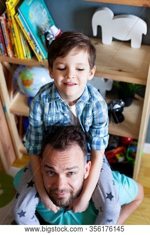 Dad Holds Son On His Shoulders, Paternity Leave