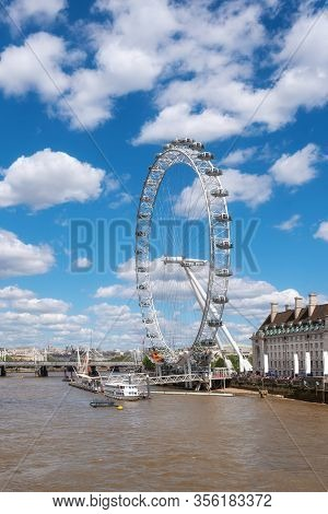 London, United Kingdom - May 13, 2019: London Skyline. Ferris Wheel And River Thames Pier, From West
