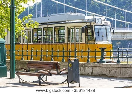 Budapest, Hungary - May 5, 2018: Tram No. 2 Moves Along Danube River Near Petofi Ter. Budapest Tram