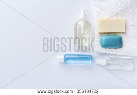 Coronavirus Protection Hand Hygiene. Many Hand Sanitizer Bottles On White Table. Alcohol Gel Antibac