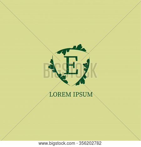 Letter E Alphabetic Logo Design Template Isolated On Green Beige Color. Decorative Floral Shield Sig