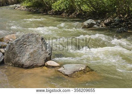 Mountain River In The Forest And Mountains. Beautiful Natural Landscape In Summer. National Park In