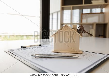 Insurance Form With Sample Of House And Keys Home Insurance Concept.