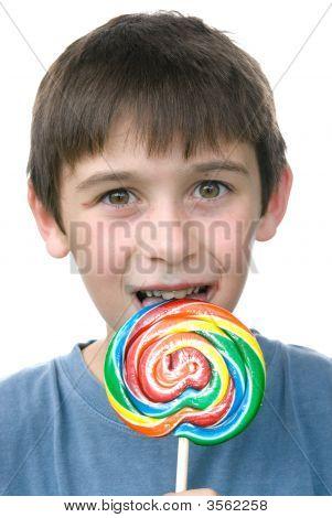 A boy enjoys his candy pin ween sucker after a big dinner poster