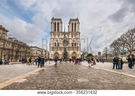 Paris, France - December 24, 2018: The Notre Dame Cathedral In Paris, France. Paris Tourist Attracti