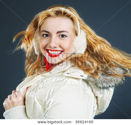 Close-up portrait of beautiful fashion girl wearing warm winter clothing