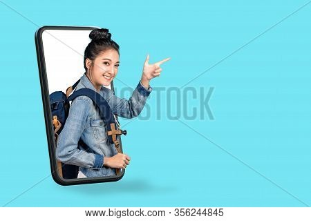 Smartphone Pop Up For Advertising.asian Woman Travel Backpacker Standing Pointing Hands To Copyspace