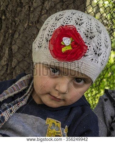 Bartang, Tajikistan - June 17, 2020:  Child In The Bartang Vally At The Pamir Highway In Tajikistan.