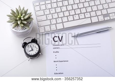 Cv With Computer Keyboard On Work Desk