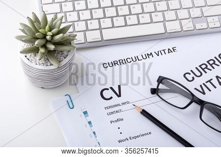 Cv, Curriculum Vitae With Keyboard On Whtie Desk