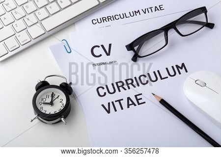 Job Interview With Cv, Clock On White Desk