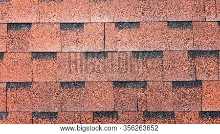 Close Up View On Asphalt Roofing Red Shingles Background. Roof Bitumen Shingles - Roofing Constructi
