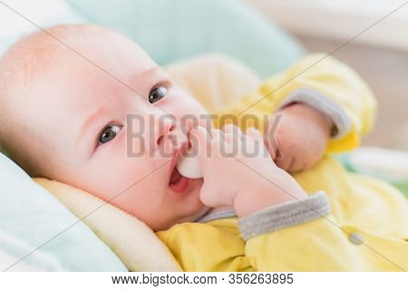 Introduction Of Complementary Foods. The Baby Will Eat Children's Nutrition. Toddler With A Spoon In