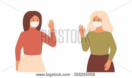 Two Women In Face Masks Maintain A Social Distance By Greeting Each Other. Young Woman And Mature Wo