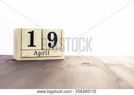 April 19th, Fourth Month Of The Clendar - Copy Space For Text Next To April Symbol