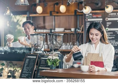 Asian Barista Preparing Cup Of Coffee, Espresso With Latte Or Cappuccino For Customer Order In Coffe