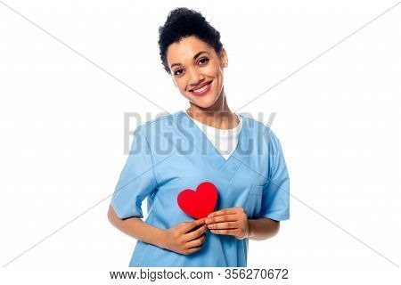 Happy And Positive African American Nurse Presenting Decorative Heart Isolated On White
