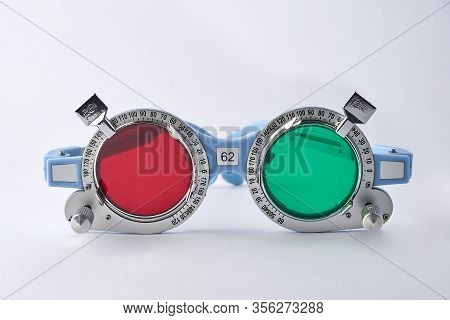 Optometrist Medical Equipment Tools Of Red Filter On Trial Frame Test, Equipment Tool For Test Visio